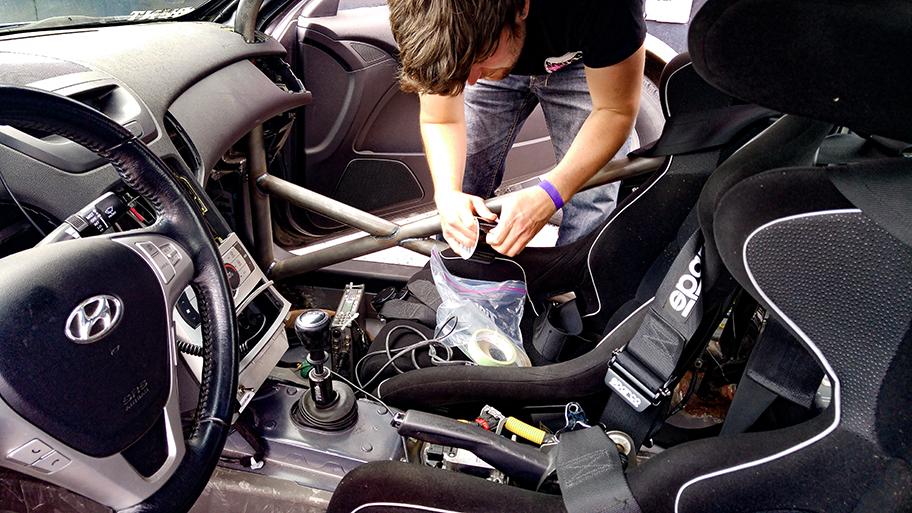 Setting up the pressure-zone mic in a race car.